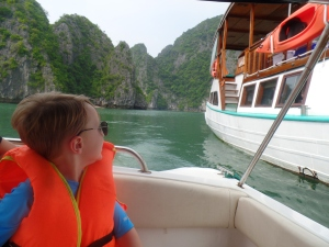 Leaving our big boat in our motor boat to the cave.